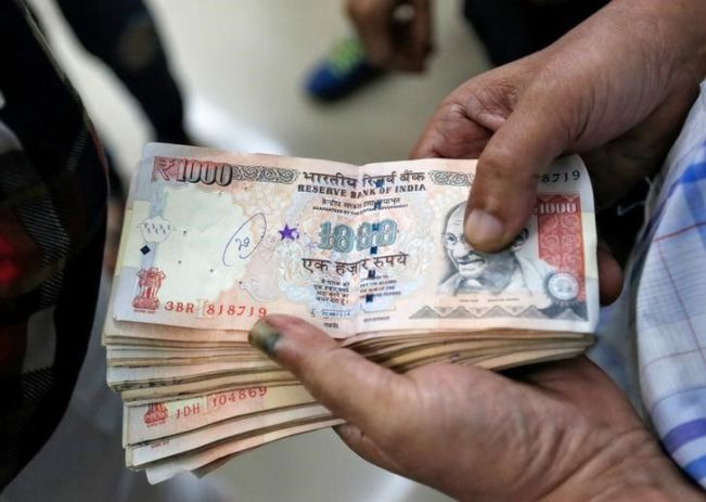 "1,000 rupee banknotes – worth 700 rupees each today, available from the newest entrants into the money-changer business. Unfortunately, their business model is fraudulent; it sure seems a strange way to ""fight corruption""."