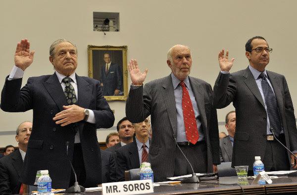 John Paulson (far left)